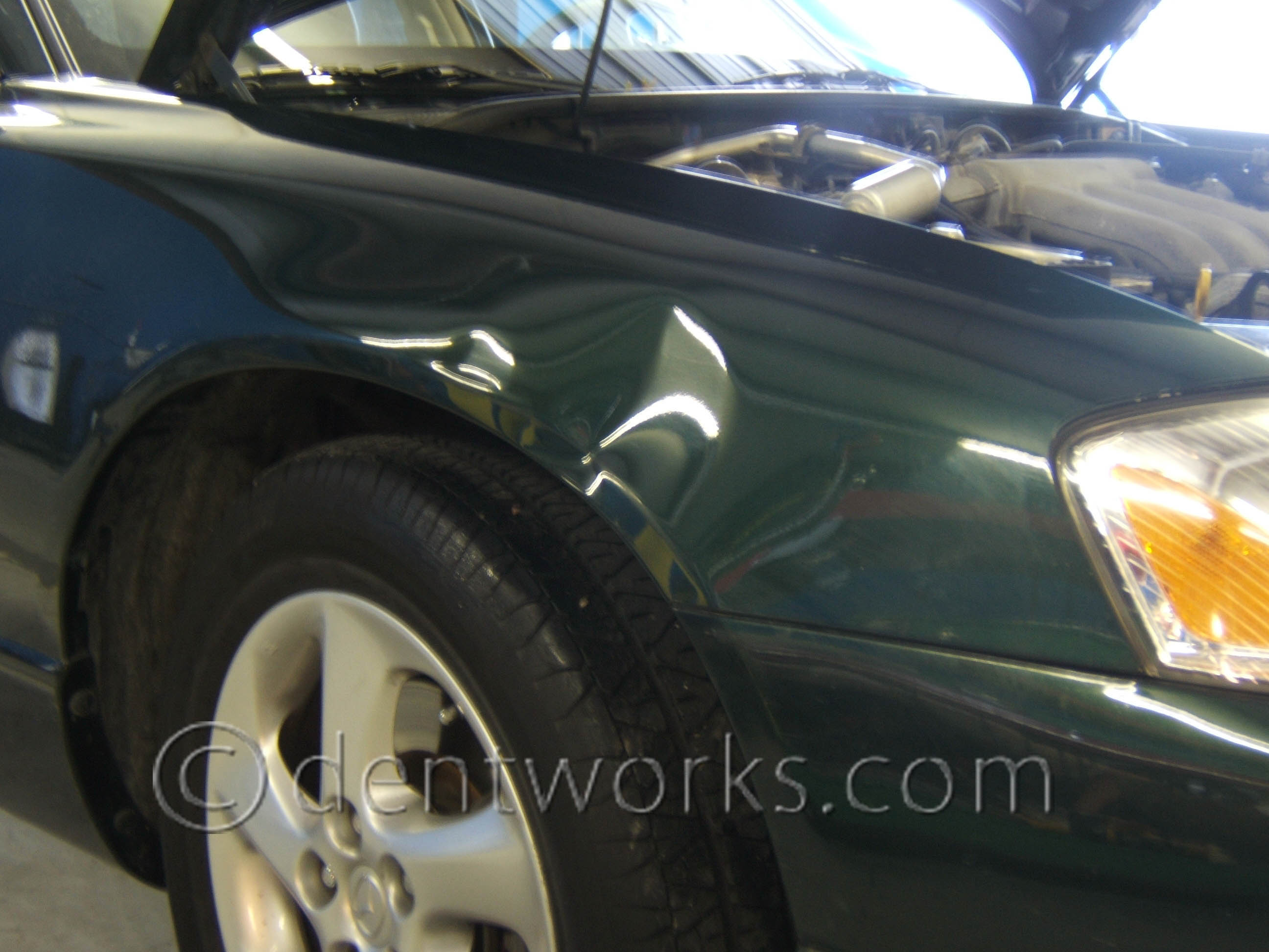 Paintless Dent Repair Before and After Pictures -- Dentworks of Austin